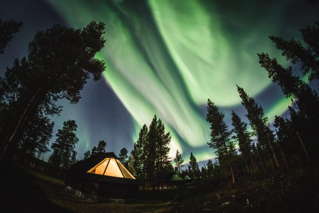 Amazing northern lights at aurora igloos in Aurora Village Ivalo Lapland Finland. Photo by Alexander Kuznetsov All About Lapland.