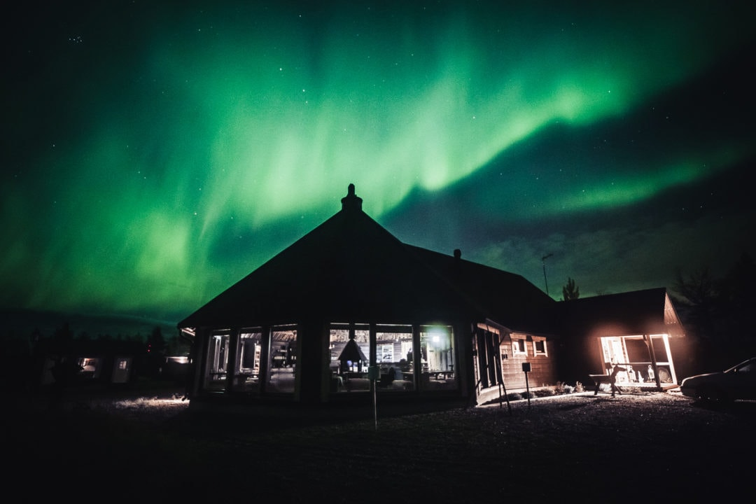 Main Building & Restaurant Loimu under the northern lights Aurora Village Ivalo Lapland Finland.