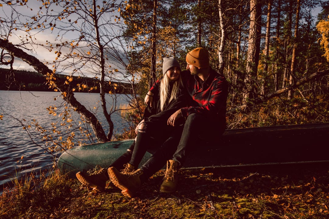 Enjoying moments together. Autumn vacation trip to Aurora Village in Ivalo Lapland Finland.