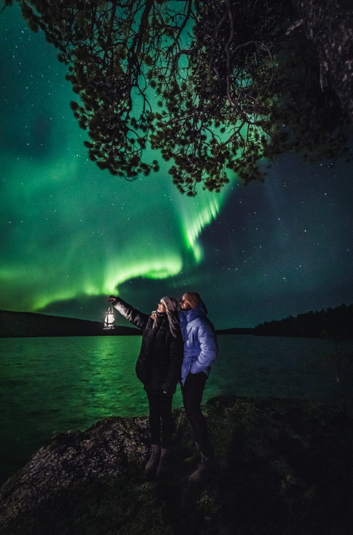 Guest of Aurora Village seeing the Northern Lights at Ivalo Inari Lapland Finland.