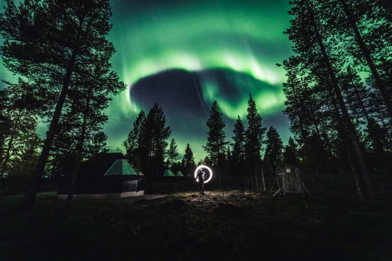 Northern Lights Glowing in the dark at the Aurora Village cottages in Ivalo Lapland Finland. Photo by Alex / All About Lapland.
