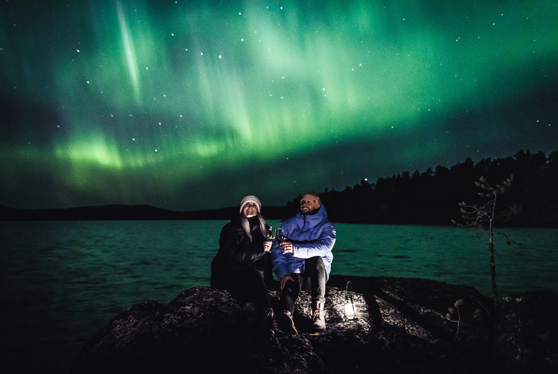 Our friends Mattia and Heini watching Aurora Borealis in Ivalo Lapland Finland.