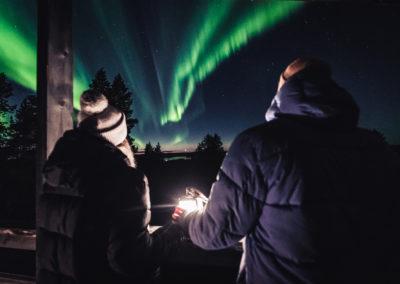 Watching the Northern Lights come alive. Aurora Village in Ivalo Lapland Finland, photo by Alexander Kuznetsov.
