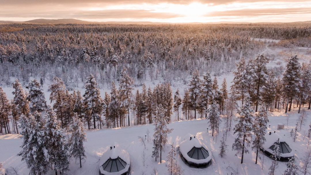 Aurora Village Winter 2019 Ivalo Lapland Finland. Aurora cottages under the sunset.