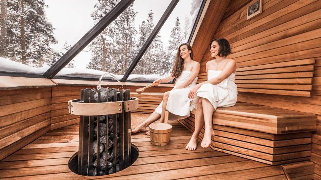 Enjoying Aurora Sauna at igloo Village in Ivalo Lapland Finland.