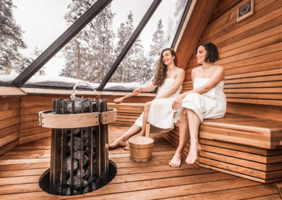 Enjoying Aurora Sauna at igloo Village in Ivalo Lapland Finland.