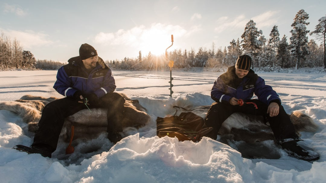 Ice Fishing at Aurora Village in Winter.