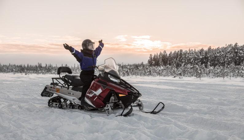 Snowmobiling at Aurora Village Ivalo Lapland Finland.